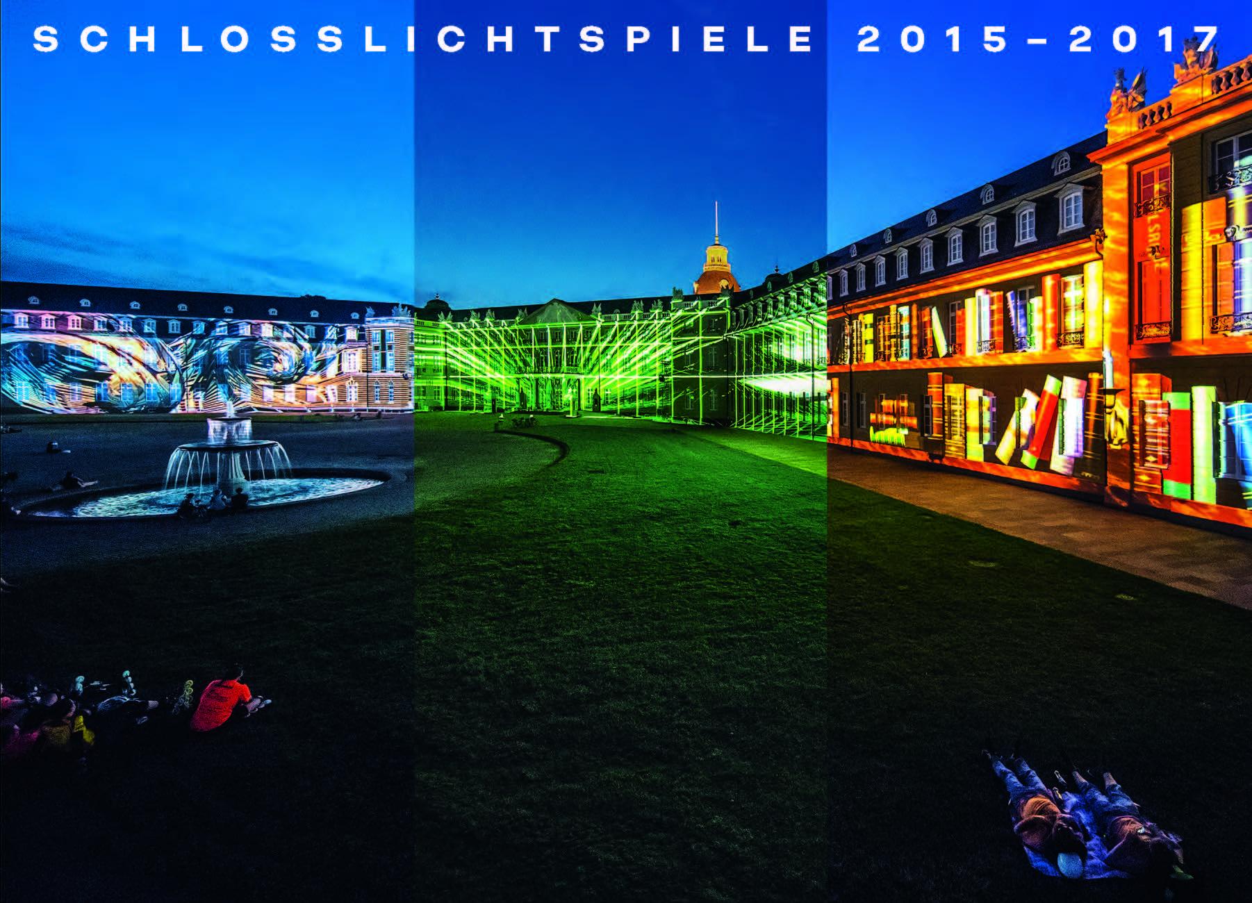 Das Karlsruher Schloss mit bunten Projektionen auf der Fassade.