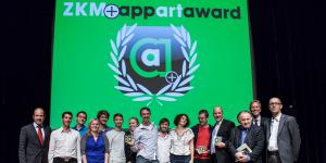 People standing in front of a green background