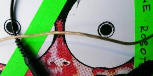 Electric cabels lay on a pixeled picture of a face. We can only make out a nose, instead of eyes, there are two cd's. Also two neonstripes are placed diagonally and vertically over the picture.