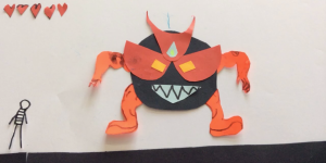 Still of an animation workshop in which a big scary monster is standing face-to-face with a little stickman