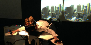 Girl trying the bird flight simulator »Birdly«.