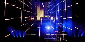 DJ duo on stage, lighting effects in the background