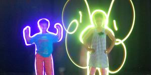 A boy and a girl posing in front of the camera. With flash lights and longterm exposure they are looking their silhouettes are looking like a butterly e.g.