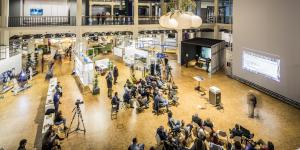The picture shows the crowded OpenHub space of the exhibition »Open Codes«