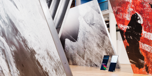 Prints of satellite images of oil extraction areas on aluminum panels