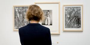 A woman is looking at different photographs