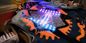 Jeans jacket with LEDs laying on a table