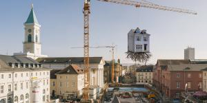 House suspended from a crane