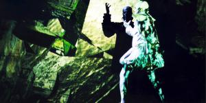Two customed people dance in green light