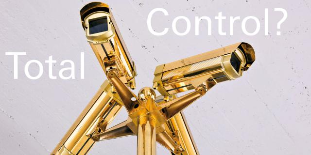 A gilded Surveillance Camera