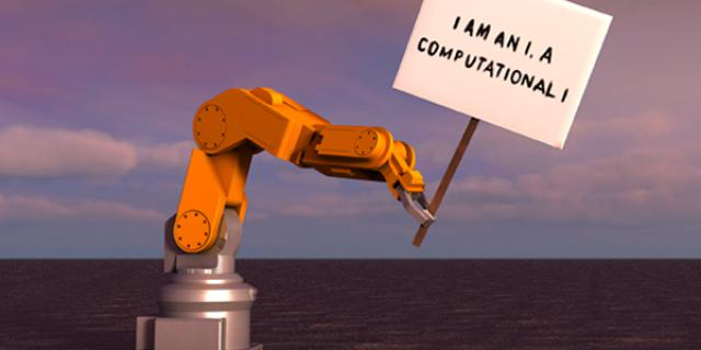 The image shows a robot on an empty crater landscape. He carries a sign with the inscription: »I am an I. A computational I.«