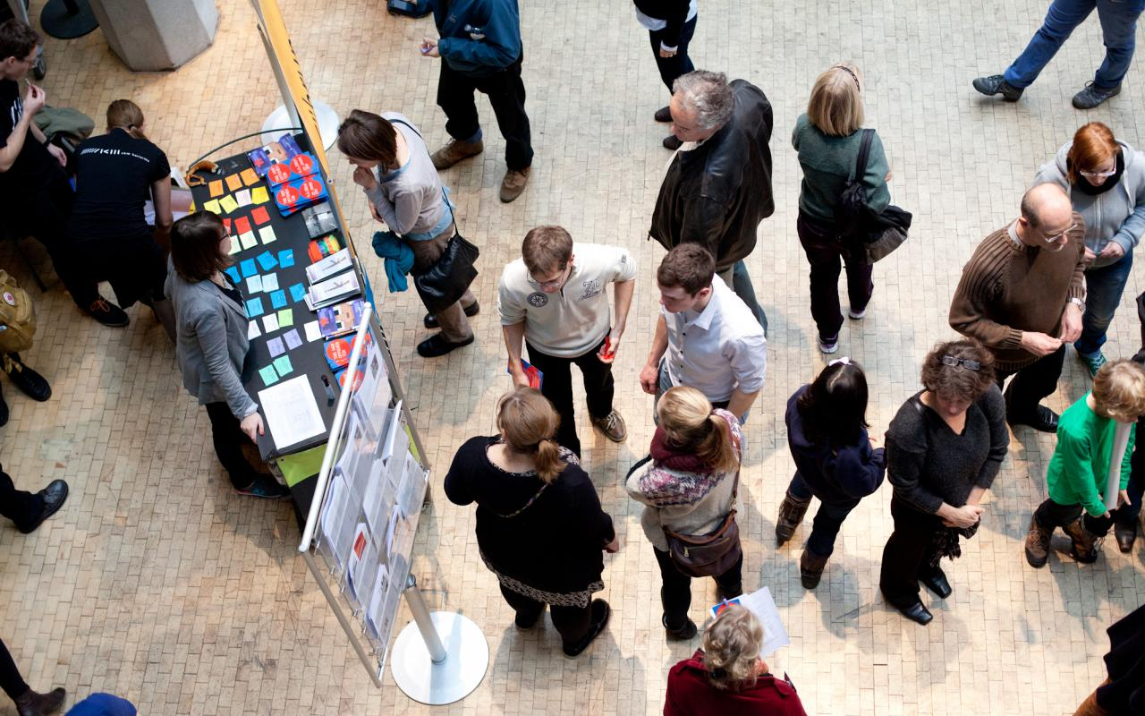 People standing in front of a stand