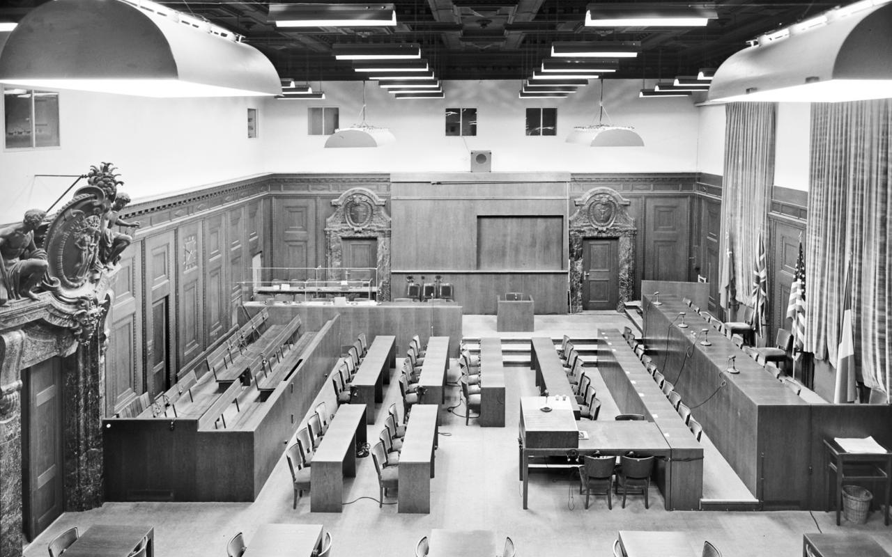 Black and white photograph from 1945, showing the empty room 600 of the Nuremberg Palace of Justice.