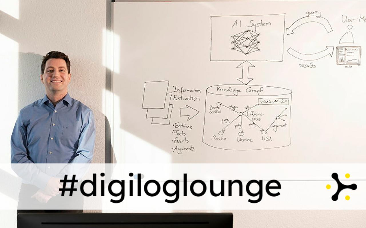 """A smiling man next to a whiteboard full of handwritten sketches of information flows involving AI. Below is the banner """"#digiloglounge""""."""