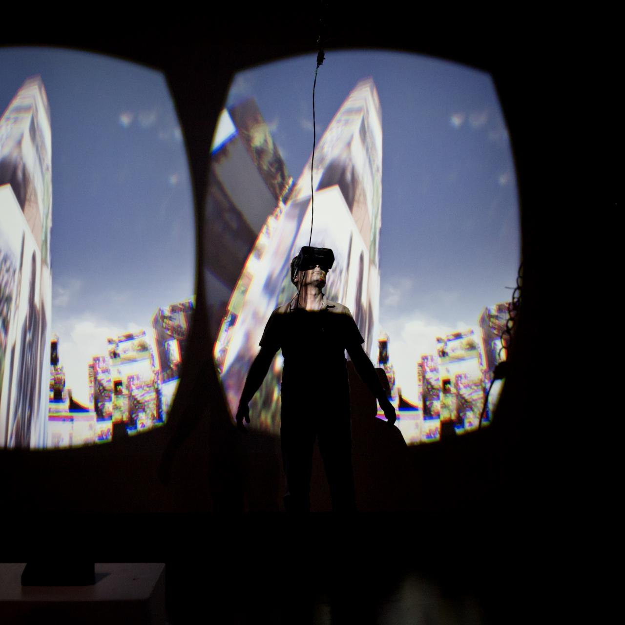 A man looking through 3-D glasses