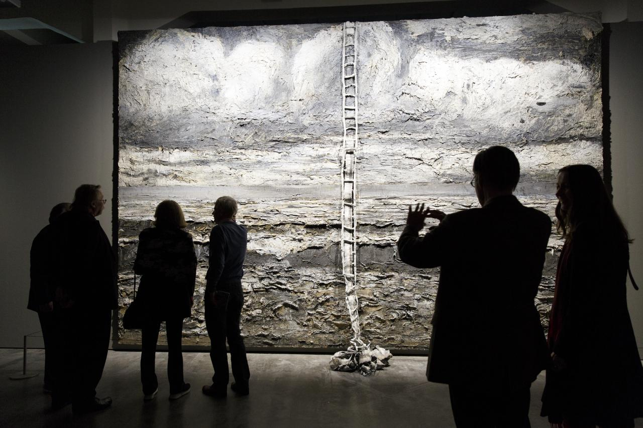 Visitors in front of the large slate of Anselm Kiefer.