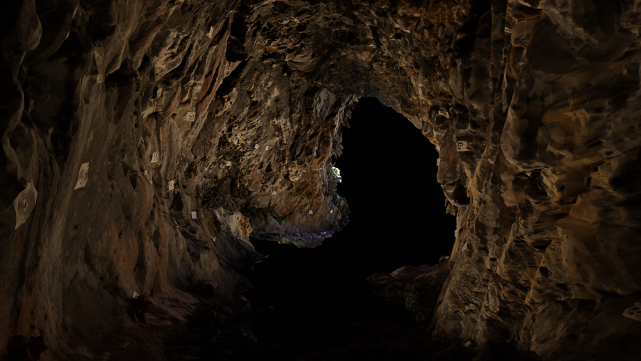 Photogrammetry image from within a cave, looking out, with visible markers used to align the photogrammetry data. Red pigments on the cave walls are prehistoric rock art.