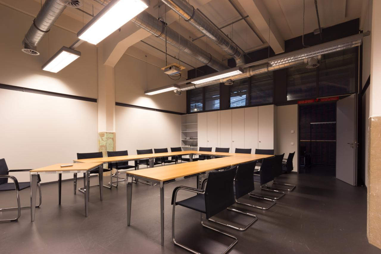 A room with a table seating for 15 persons