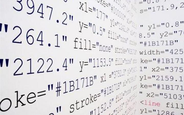 Perspective photography of a wall installation with computer code