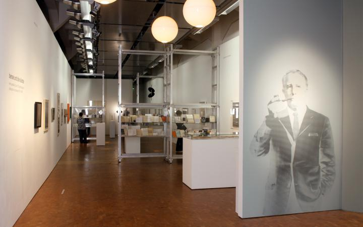 View of the exhibition »Bense and the Arts«. On the right hand side a portait of Max Bense.
