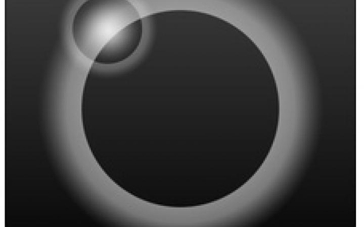 A black circle with white shadow