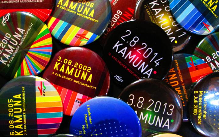 A lot of multi-colored buttons of past KAMUNAs
