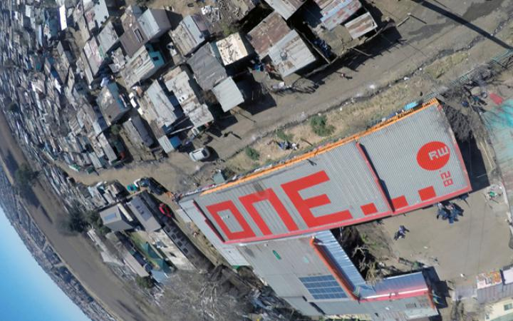 "The word ""one"" in red letters on a roof"