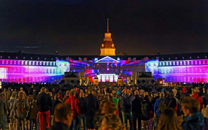 The Karlsruhe Palace is bathed in colorful light