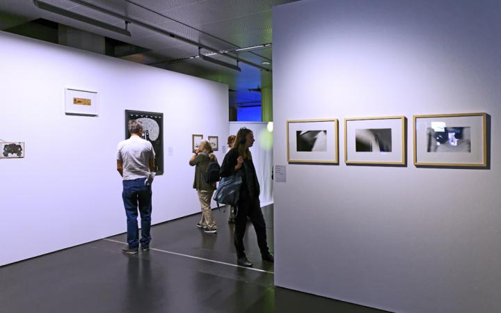 People looking at paintings on the wall