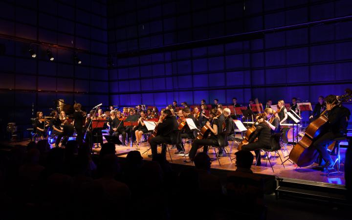 An orchestra at the stage