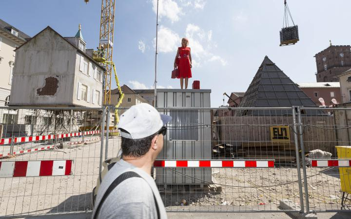 A woman standing in the middle of a construction site