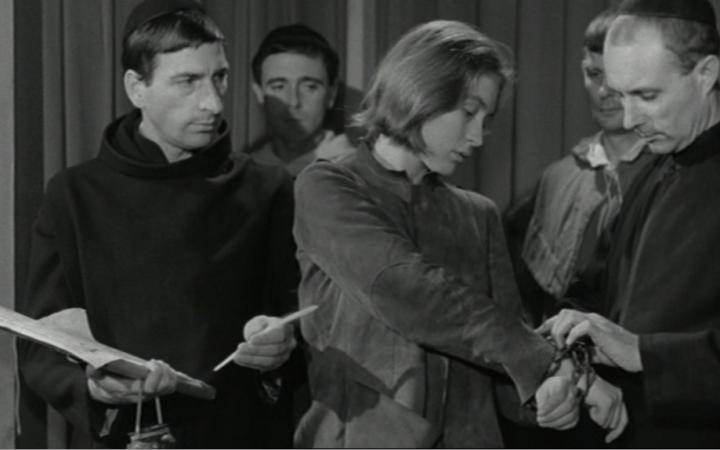 A man puts a woman in handcuffs.