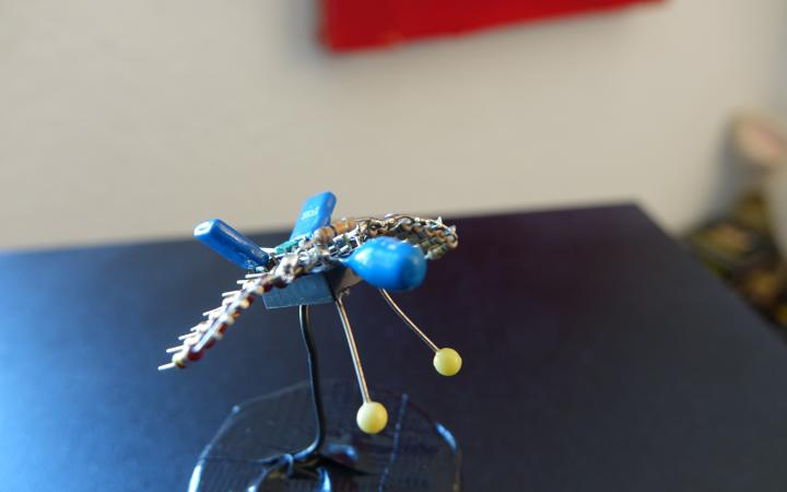 A fly, brazed together from electronic waste