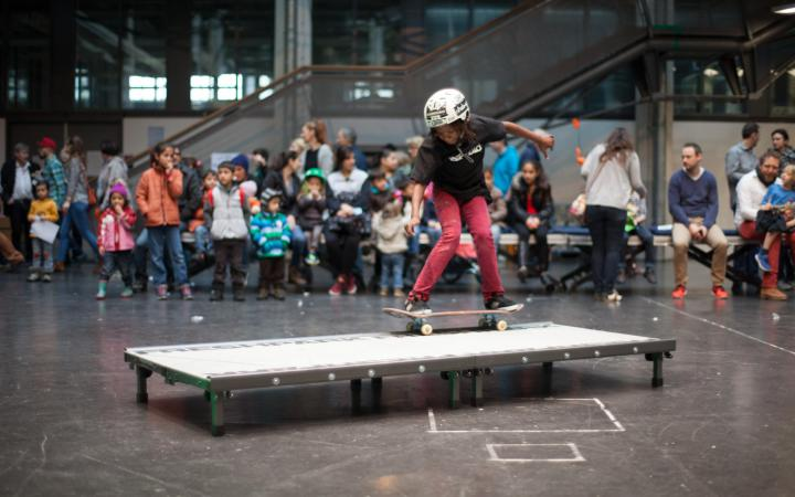A girl riding the skateboard