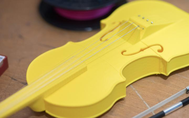 A yellow violin from the 3D printer