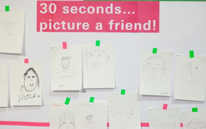 A wall full of handmade portraits