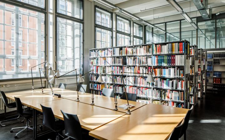 The ZKM Library with desks. In the background bookshelves