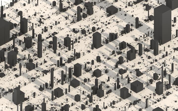 Graue Quader in verschiedenen Größen auf ebener Fläche. Sie sehen aus wie eine Stadt aus Hochhäusern.