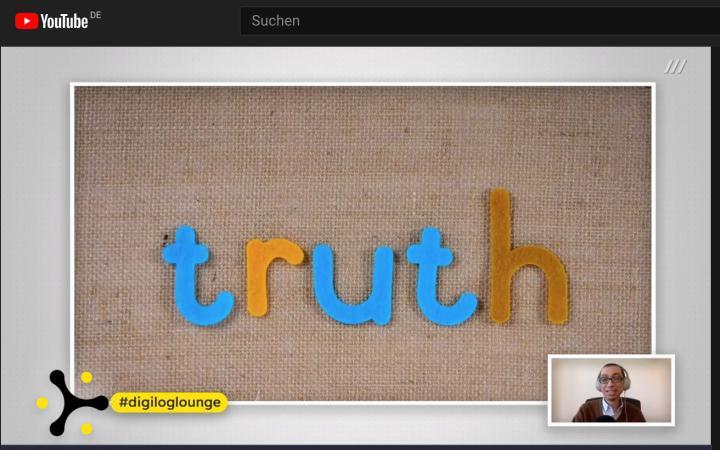 Screenshot eines digitalen Experten-Talks mit dem Wort »truth« groß auf dem Bildschirm