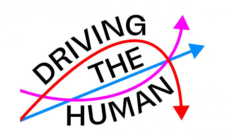 """It is written """"Driving the Human"""". Under the """"The"""" is a straight arrow from left to right. Under """"Driving"""" there is a downward arrow and under """"Human"""" there is an upward arrow."""