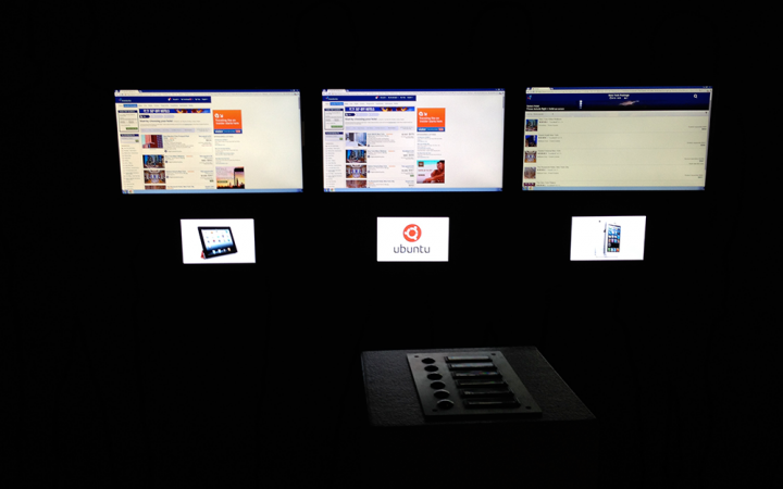 Three screens are showing diverse operating systems