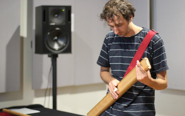 A man plays on a musical instrument
