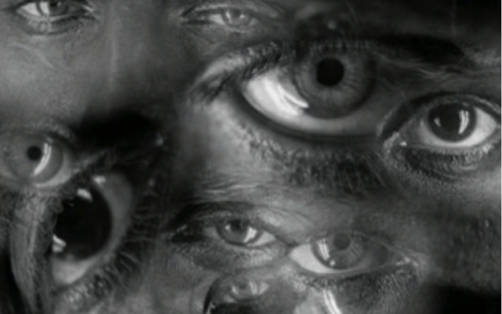 The black and white image shows a collage of numerous pairs of eyes