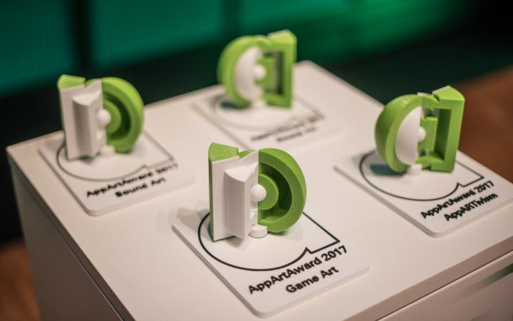 Four green trophies