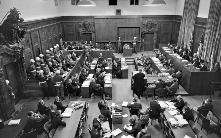 Black and white picture of many people in a courtroom