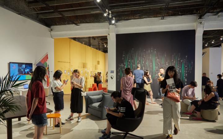 People in an exhibition space