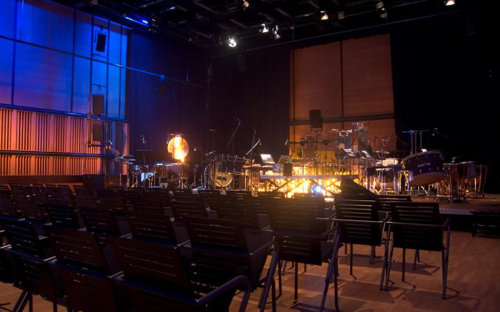Empty theater seating in ZKM_Cube with orchestra construction on stage