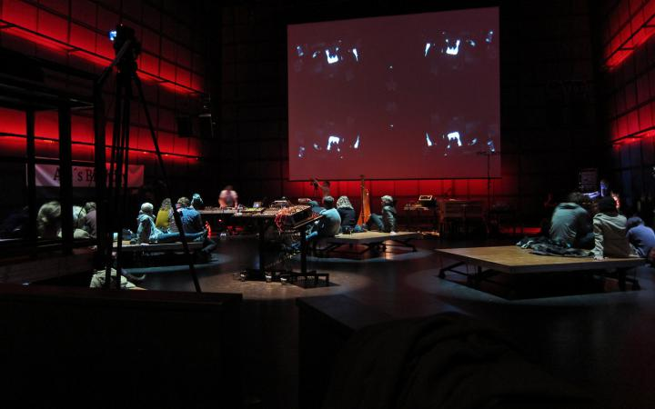 ZKM_Media Theater without seatings, people sitting on the floor