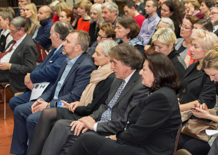 The photo shows the full hall at the opening of the exhibition