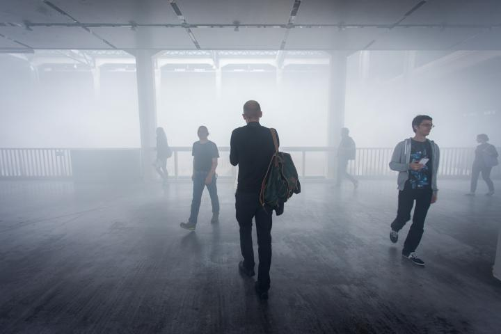 People walking through fog